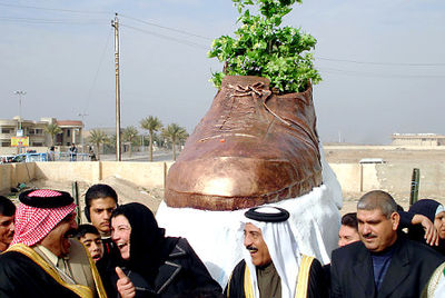 bronzed shoe statue